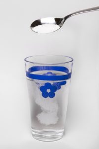 glass of water with sugar