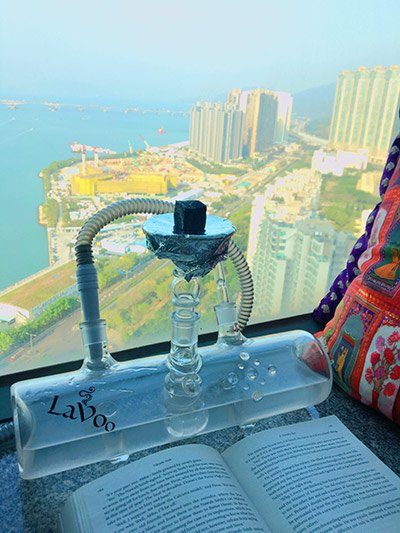 Lavoo hookah in use and seascape view from a condo