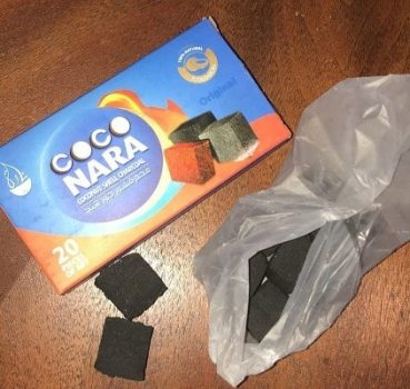 pack of Coco Naras and two charcoals on the table